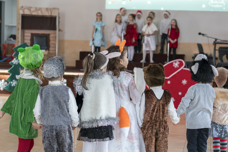 childrens music groups sing and dance at the graduation concert. Children in front of their parents show what they have learned. Emotional childrens musical shows