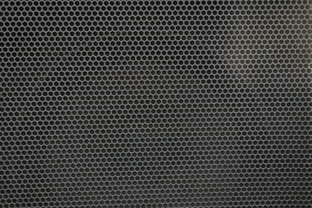 Black iron with small holes. background