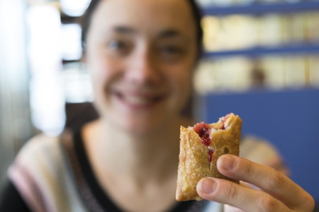 Happy girl holding a cherry pie