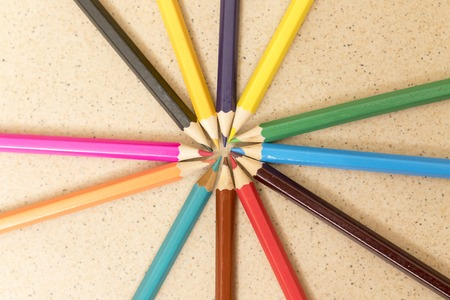 Ring of pencils isolated on a light background