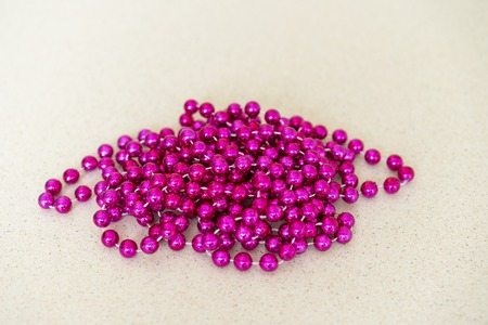 long pink beads on a light background Stock Photo