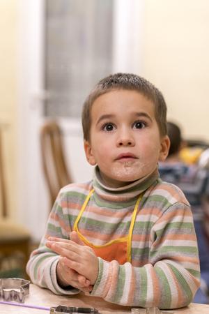 little boy sculpts out of dough