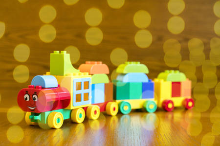 Childrens locomotive with wagons, blue bokeh.