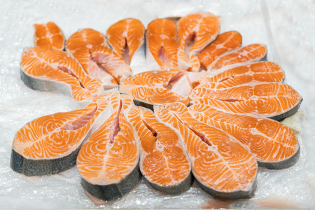 The big pieces of red fish on ice in the fish market.