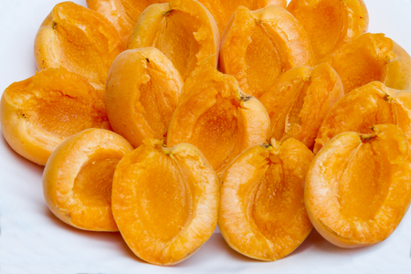 Peeled apricot on a plate. Peeled fresh apricot on a white plate without pits. Healthy and natural food