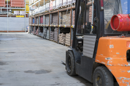 forklift in a construction shop. Construction Materials.