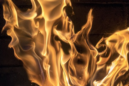 Bright fire in the fireplace close-up. red-yellow fire background. Stock Photo