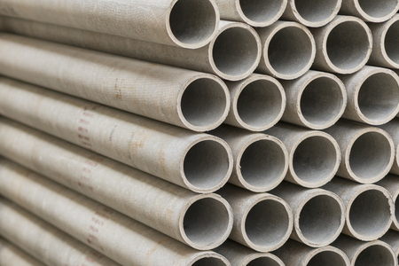 asbestos pipes in a stack in a warehouse or in a building store.