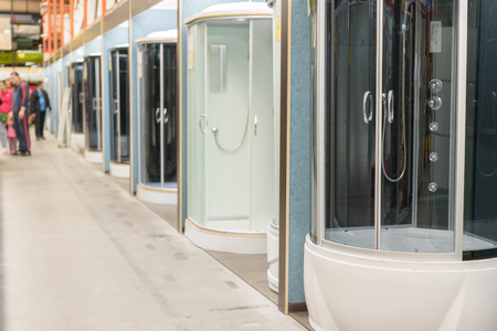 Shower cabins in the sanitary ware shop. inside HomePro store. The store provide advice and facilities for installation and maintenance of a wide range of domestic features