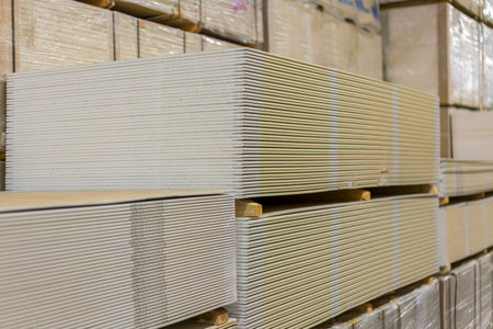 Pallet with plasterboard in the building store.