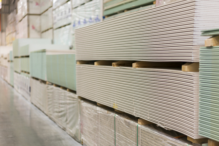 Gypsum plasterboard in the pack Stock Photo