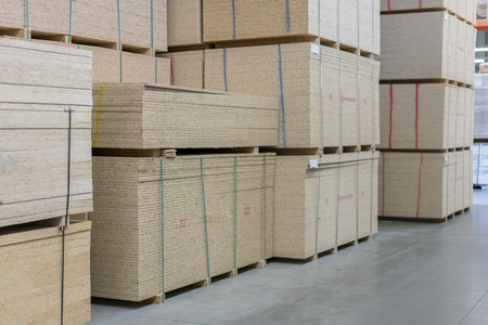 Warehouse of fiberboard and chipboard. Construction Materials. Wooden warehouse.
