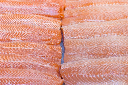 Salmon Fillet in Ice on the supermarket counter. Fillet of red fish in the ice in the supermarket. Marine healthy food.