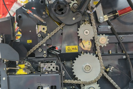 Close up of chain on gear on agricultural machine.