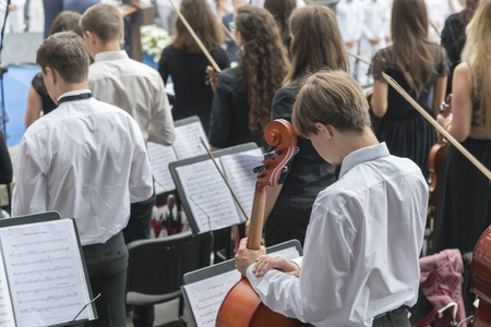 Men with a cello in an orchestra Stock Photo