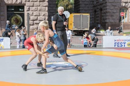 Ukraine, Kiev, Ukraine 09.09.2018 Indicative street performance wrestlers. Promotion of healthy lifestyles. boys on street tatami engaged in Greek wrestling.