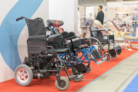 Wheelchair at a medical exhibition. Wheelchair with electric motor.