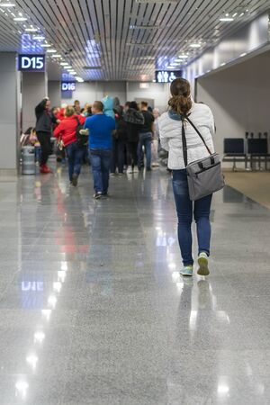corridor to the boarding gates of the international terminal, passengers are landing. vertical photo.