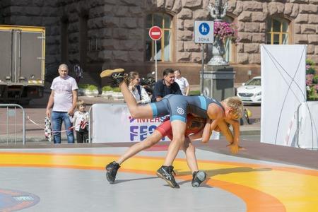 Ukraine, Kiev, Ukraine 09.09.2018 Indicative street performance wrestlers. Promotion of healthy lifestyles. boys on street tatami engaged in Greek wrestling