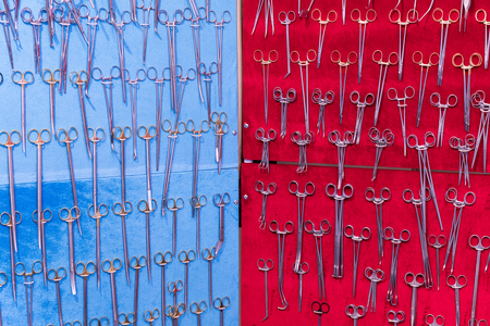Gynecological instruments on blue background and red background. 스톡 콘텐츠