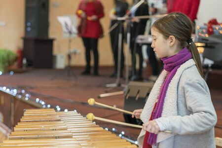 Girl 9 years old playing professional xylophone. Stok Fotoğraf
