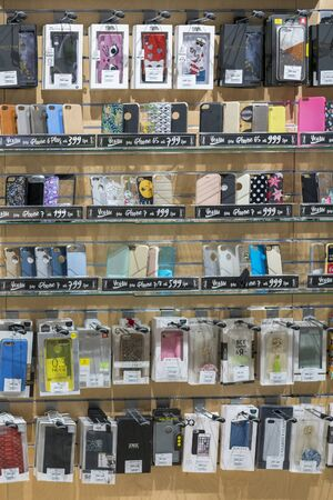 Kiev, Ukraine. January 15 2019 Colorful iPhone And Samsung Phone Cases For Sale In Mobile Phones Stores. Different design of mobile phone covers in cell phone accessories store. vertical photo.