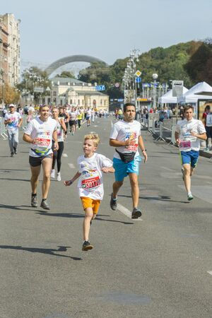Ukraine, Kiev, Ukraine 09.09.2018 athletes and amateurs are running. People are engaged in running. Promotion of healthy lifestyles. Children and parents take part in the race.
