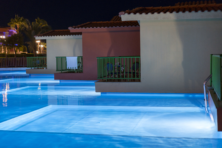 Hurghada, Egypt. November 19 2018 Hurghada, Egypt. November 19 2018 luxury resort with pool at night view. hotel outdoor landscape with pool. Night pool side of rich hotel.