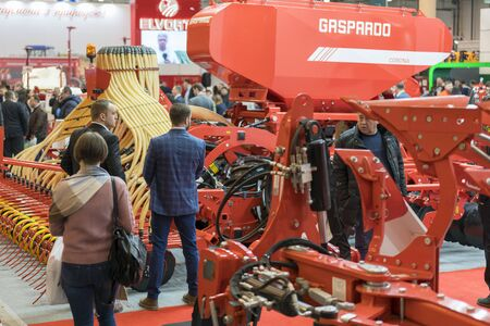 KYIV, UKRAINE - February 25, 2019: Combines, tractors and machinery during the agricultural exhibition INTERAGRO - 2019. Farmers use machinery at the exhibition
