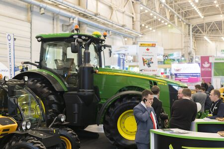 KYIV, UKRAINE - February 25, 2019: Combines, tractors and machinery during the agricultural exhibition INTERAGRO - 2019. Farmers use machinery at the exhibition. Sajtókép