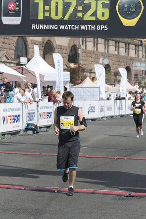 Ukraine, Kiev, Ukraine 09.09.2018 athletes and amateurs are running. People are engaged in running. Promotion of healthy lifestyles. Man finishes marathon. vertical photo