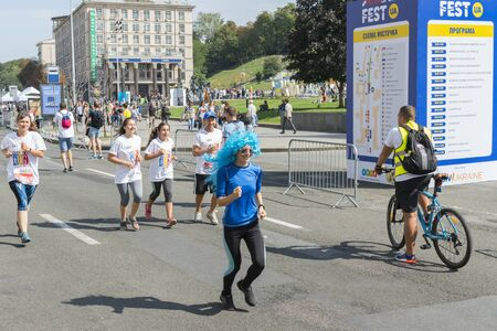 Ukraine, Kiev, Ukraine 09.09.2018 athletes and amateurs are running. People are engaged in running. Promotion of healthy lifestyles. Parents and children run a marathon