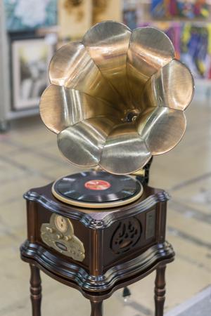 Modern gramophone. Turntable vinyl record player. vertical photo.