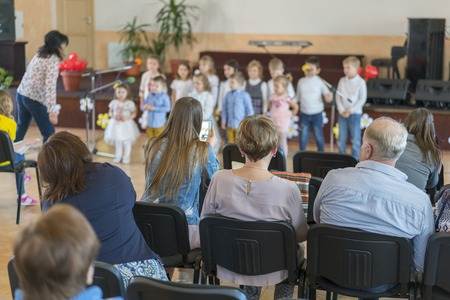Performance by talented children. Children on stage perform in front of parents. image of blur kid s show on stage at school , for background usage. Blurry. 版權商用圖片