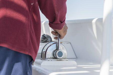 A man drives a yacht. close-up.