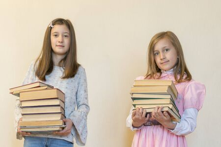 Children with books in their hands. Imagens