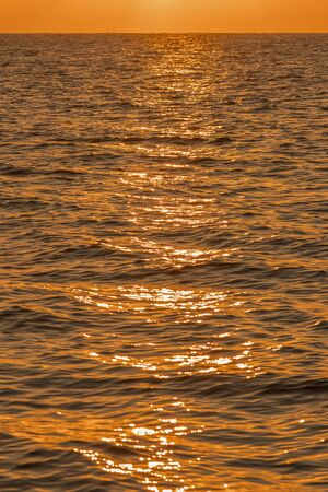Colorful dawn over the sea, Sunset. Beautiful magic sunset over the sea. Beautiful sunset over the ocean. Sunset over water surface. vertical photo. Imagens