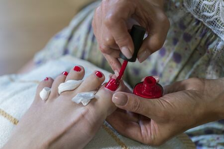 pedicure process macro closeup. pedicure process and spa procedure macro closeup. Concept body care. nail beauty process, polishing and painting. close up