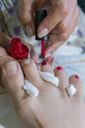 pedicure process macro closeup. pedicure process and spa procedure macro closeup. Concept body care. nail beauty process, polishing and painting.