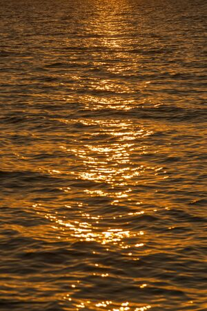 Colorful dawn over the sea, Sunset. Beautiful magic sunset over the sea. Beautiful sunset over the ocean. Sunset over water surface. vertical photo. Фото со стока