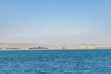Unfinished houses by the sea. Unfinished buildings of new hotel resort in Egypt.