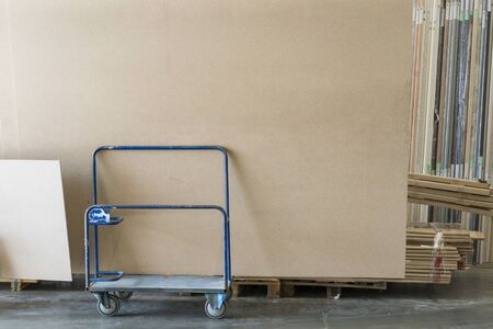 Trolley in a hardware store with building materials. Warehouse large storage.