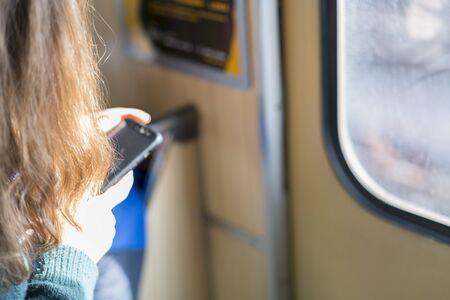 Woman with smartphone in subway. selected focus. Banco de Imagens