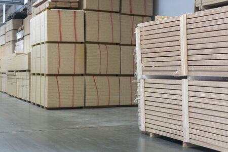 Warehouse tree. Pallets with wooden plates in a warehouse or in a hangar. Lumber production.