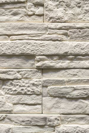 Gray decorative stone background. Gray wall background of concrete block texture. vertical photo. Banco de Imagens
