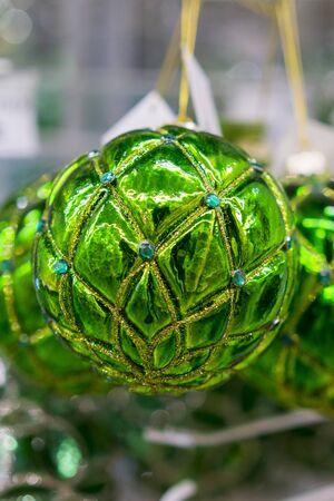 Christmas balls. Christmas baubles. Green christmas balls. Christmas toys background for a Christmas card, Christmas wallpapers. vertical photo.