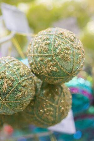 Christmas balls. Christmas baubles. Green christmas balls. Christmas toys background for a Christmas card, Christmas wallpapers. vertical photo