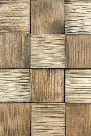 wooden background. Background of wooden squares. beige wood background. vertical photo.