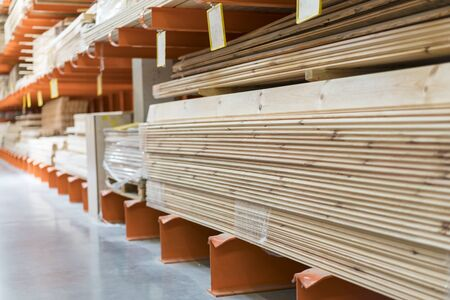 Boards on a rack in a construction store. Construction and repair concept. Stock fotó - 133999343
