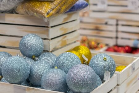 Christmas decorations in boxes. Balls for Christmas tree of blue light. Christmas preparation concept. Christmas background for cards and congratulations.